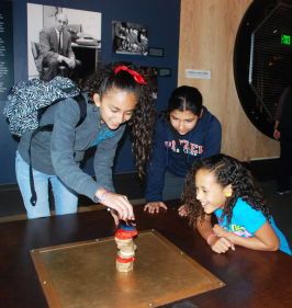 These scholars are building a sturdy structure on a shake table at the Exploratorium in San Francisco.
