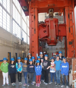 DaVinci Camp stands next to the big red testing machine at the Richmond Field Station.