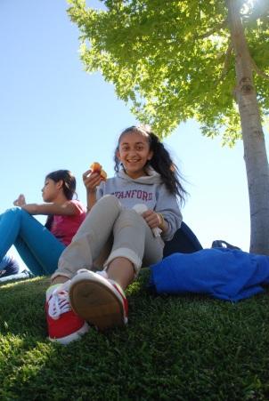 This scholar enjoys break time under a tree at Stanford University.
