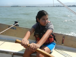 A scholar gets the opportunity to sail one of the boats thanks to the Cal Sailing Club.