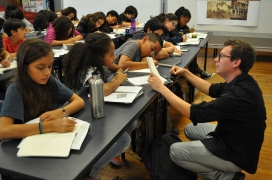 The political cartoons instructor reads out loud a student's response to the article.
