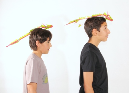 At E&M labs, these scholars get to pose with one of their model dragon toys.