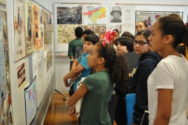 The scholars see a variety of propaganda posters from several countries involved in the Great War.