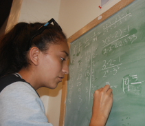 This scholar works with fractions, with the techniques provided by DaVinci Camp.