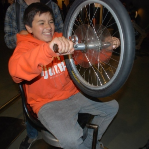 This scholar experiences first hand a type of gyroscope and angular momentum at the Exploratorium.