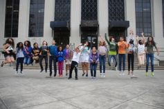 DaVinci Camp scholars performing a wave jump in front of VLSB at UC Berkeley.