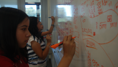 Scholars working on different numeral systems at Stanford University.