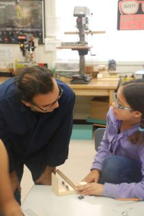 DaVinci Camp staff answers scholar's question at Dr. George Castro's Science Workshop in San Jose.
