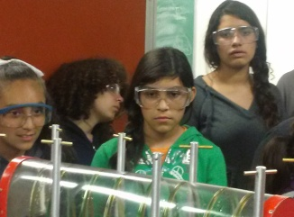 A few DaVinci Camp scholars are mesmerized while looking at an engine at the Hesse Lab in the Mechanical Engineering Department at UC Berkeley.