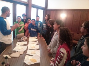 Orlando Murillo gives a presentation to the scholars about the varieties of cheeses found at the Cheeseboard, at UC Berkeley.