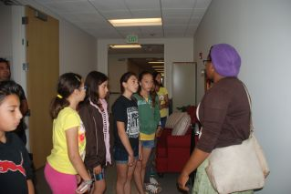 Stanford University Graduate Student, Crystal Bray, shows the scholars around the physics lab after a campus tour.