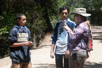 Geologist Sarah Beroff explains to some scholars the types of faults and the differences in their plate's motions.