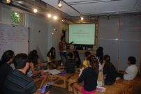 Graduate student Michelle, gives a presentation about the Design School at Stanford to the students.