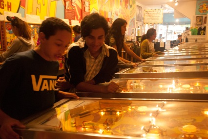 These scholars play an enthralling game of pinball at the Pacific Pinball Museum in Alameda.