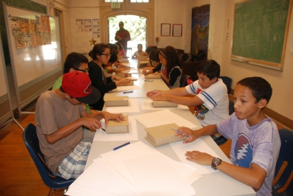 DaVinci Camp scholars were given a workshop by artist and production designer, Simon Varela, that showed them how to create art on books related to Mayan traditions