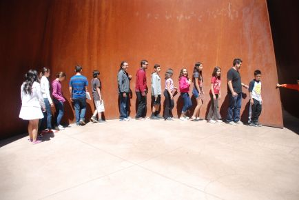 """The scholars and staff walk along Richard Serra's sculpture """"Sequence"""", outside of the Cantor Arts Center at Stanford, and discover the different movements and shapes the sculpture takes."""
