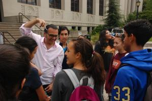 """DaVinci Camp making use of the acoustics outside of VLSB in Berkeley, and listening to """"O Fortuna""""."""