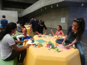 Scholars learn about urban planning with James Rojas, MIT alumni, at the Berkeley Art Museum.