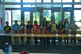 At Stanford University, Simon Varela and the scholars show off their Mayan inspired books.