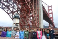 DaVinci Camp takes a picture with a spectacular view of the Golden Gate Bridge, from Fort Point!