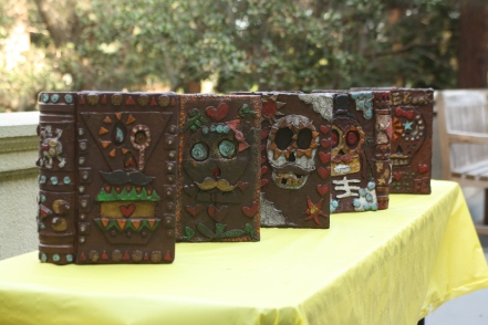 The books of art that the scholars created are put outside to dry after painting, wrapping up their art project.