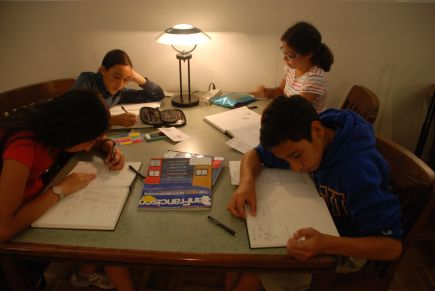 In Palo Alto, the scholars quietly do math in the library after spending some time in the Clay and Glass Festival.