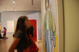 Scholar observes the magnificent art of the Cantor Center for Visual Arts at Stanford.