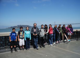 Outside the Exploratorium, the group takes a pictures with the Bay Bridge in the background!