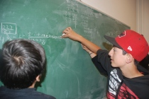 Scholars learn to work together. Here a scholar helps his new friend understand the concepts at hand at UC Berkeley.