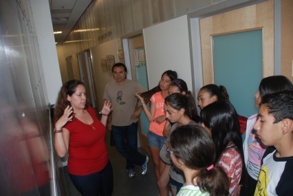 Dr. Viviana Acevedo-Bolton shares her research about air quality with the scholars, emphasizing the importance of the research at Stanford University.