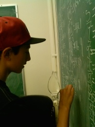 Scholar takes advantage of the opportunity to do math on the Berkeley Chalk Boards.