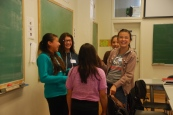 The scholars share a joke and break the ice over introductions.