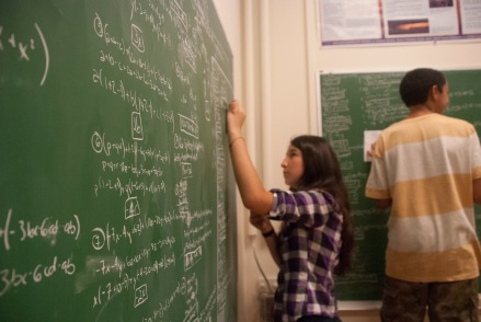 This DaVinci camp scholar fastidiously works through her addition of polynomials