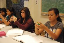 scholars look for middle edge pieces on the Rubik's cube to start solving the first step; the cross.