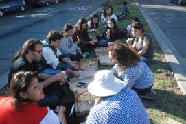 """The scholars and staff enjoy Cheeseboard pizza before they watch the """"Comedy of Errors."""""""