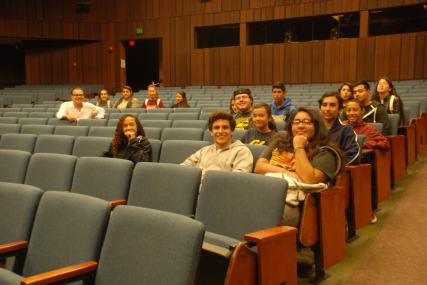 Inside of UC Berkeley's Wheeler Hall, the scholars smile for the camera.