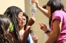 The scholars test how many holes the aluminum cap will take before its gives out and the water escapes.