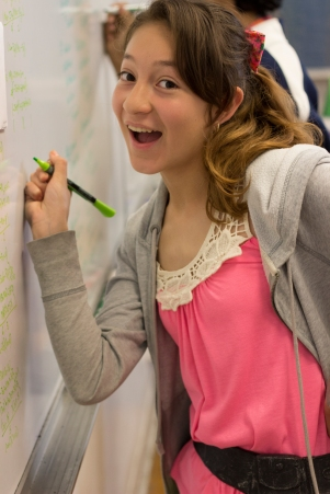 The scholar poses with her marker in hand demonstrating that you can work and have fun at the same time.