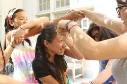 During a break, scholars and staff unwind by unwinding themselves playing the human knot.