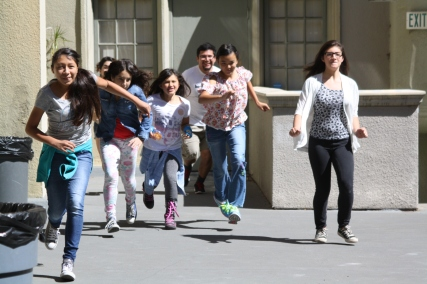Scholars race to the finish line during a game of Red Light Green Light.
