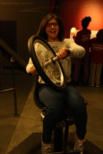This scholar feels her chair rotating as she turns the spinning bicycle wheel.