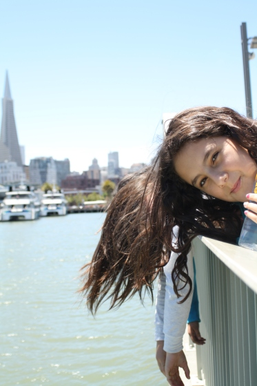 This scholar leans over to get a better view of the San Francisco Bay on a field trip to the Exploratorium.