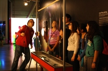At the Exploratorium, DaVinci Camp staff blows on the soapy film to create a colorful ripple.