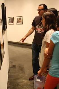 While visiting the Berkeley Art Museum, DaVinci Camp staff points out details in drawings on display.