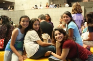 DaVinici Camp puts forth their best smiles while listening to Sovoso acapella perform at the Berkeley Art Museum.