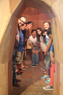 DaVinci Camp group poses in an installation at the Berkeley Art Museum.