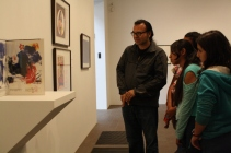 DaVinci scholars and staff take in the different pieces of art belonging to the larger piece entitled One Cent Life.