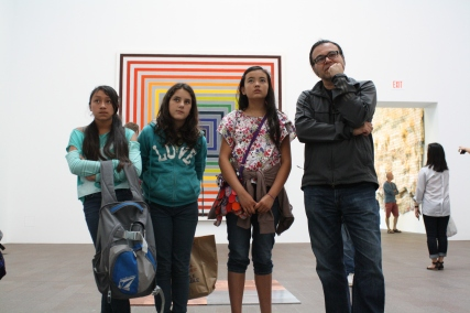 These scholars and staff member take in the simplicity of minimalist art.