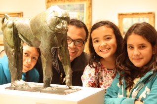 DaVinci Camp scholars and staff pose with this piece of a baboon at The Legion of Honor.