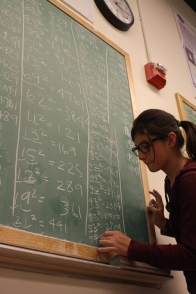 A scholar endeavors to squeeze in as many squared numbers as she possibly can.